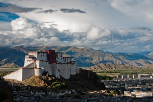 An image of Shigatse Dzong, Shigatse, Tibet. Shigatse is the second largest city of Tibet, and the Shigatse Dzong is the traditional seat of Panchen Lama (the second most senior lama). It is built as a smaller prototype of the Potala Palace in Lhasa.